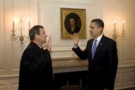 "Chief Justice Roberts ""reswears"" in Obama, in the Oval  Office."